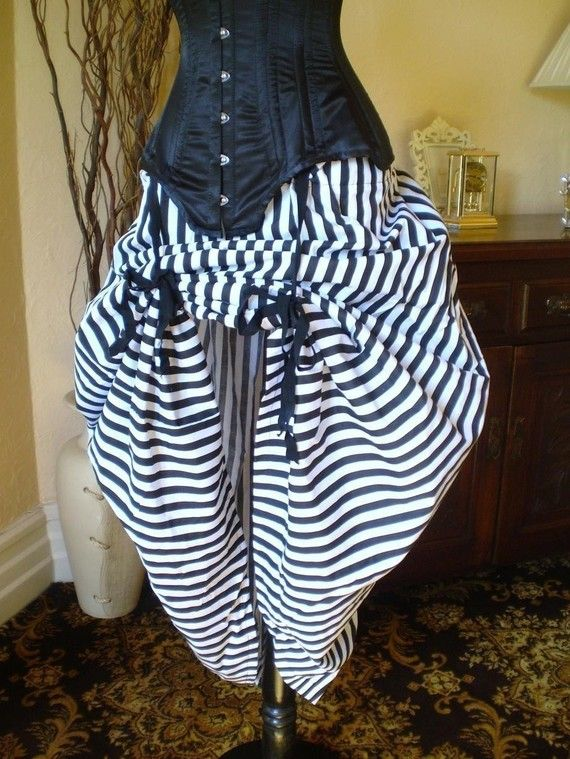 They say if you convo them, they can make the bustle skirt in different colors. The underskirt and corset you'll have to get separate.   Black and White Circus Bustle SkirtOne Size Fits by AliceAndWillow