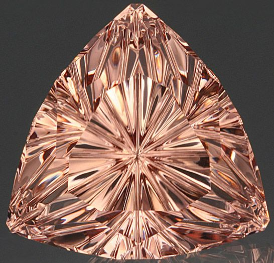 John Dyer | 50.92 ct. trillion custom-cut morganite an AGTA Spectrum Award for cut. Morganite is the pink variety of beryl.