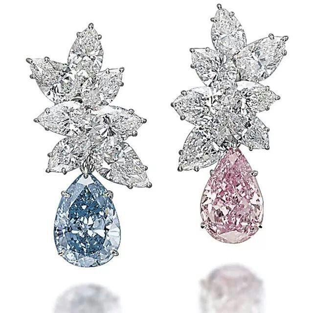 A pair of coloured diamond ear pendants, set with pear-shaped diamonds in Fancy blue and Vivid pink, achieved the second highest price at Christie's Magnificent Jewels Sale in Geneva, selling to Laurence Graff for $15.82 million.