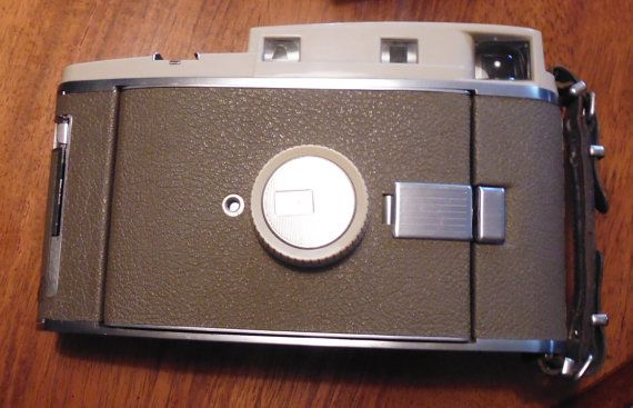 Polaroid 800 Land Camera set, camera flash, ASA 3000, orange filter, wink light, camera bellows, folding camera