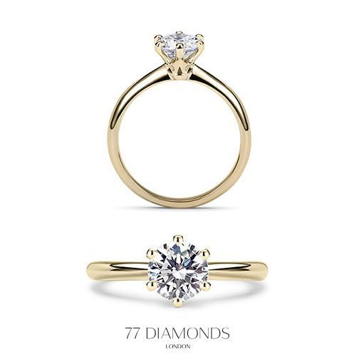 The classic Allure engagement ring in yellow gold set with a 1ct round diamond.
