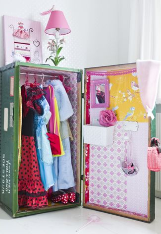 Nifty closet or dress up area. Turn a travel trunk on it's side and decorate!