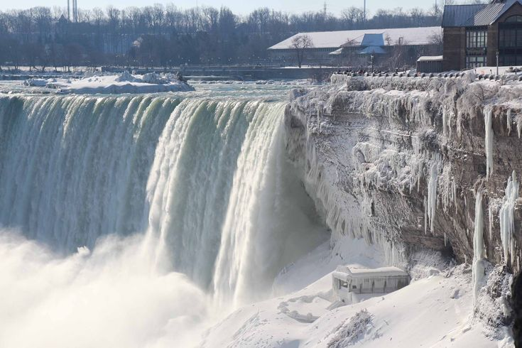 74 Of The Most Amazing News Photos Of 2014:  A view of Niagara Falls frozen over due to the extreme cold weather, Ontario, Canada, Jan. 9. The Polar Vortex brought record cold temperatures to United States and Canada. Anadolu Agency / Getty Images