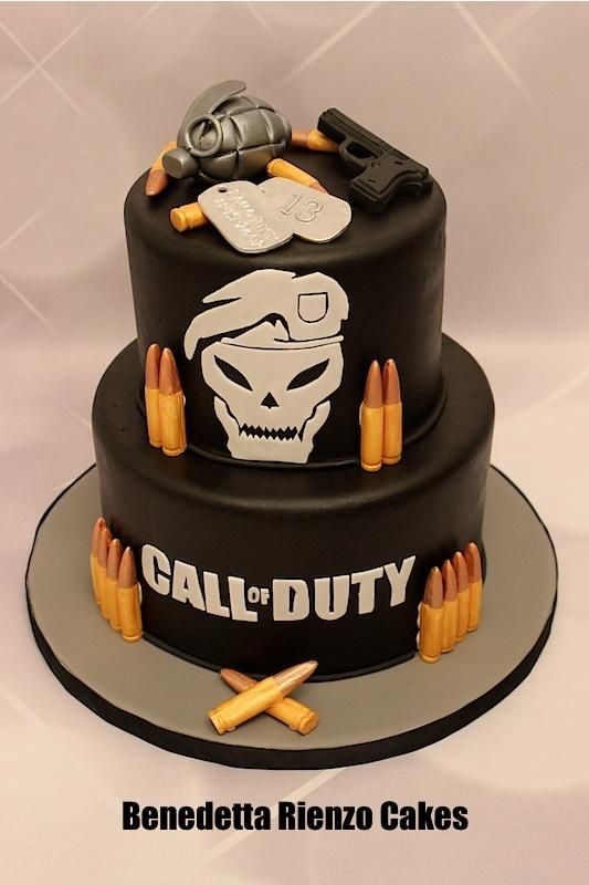 Call of Duty Black Ops theme cake. Hand cut skull face, lettering, dog tags. Molded bullets and gun. Grenade hand modeled from gumpaste. Marble cake filled with cookies and cream swiss meringue buttercream. :)