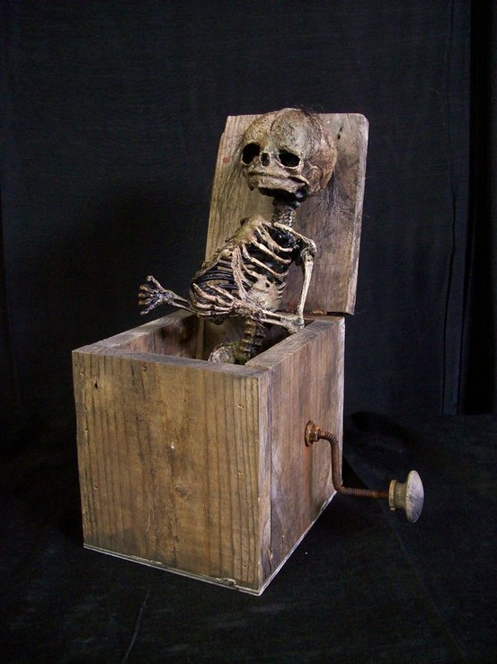 Skeleton Jack in the box--Kind of like death...pops up when you least expect it.