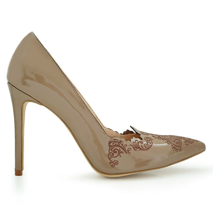 Stiletto high heels inspired by Islamic art. Made from natural leather…