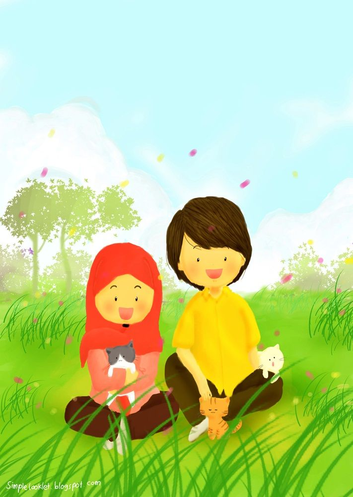 Muslim Boy and Girl Sitting in Green Field
