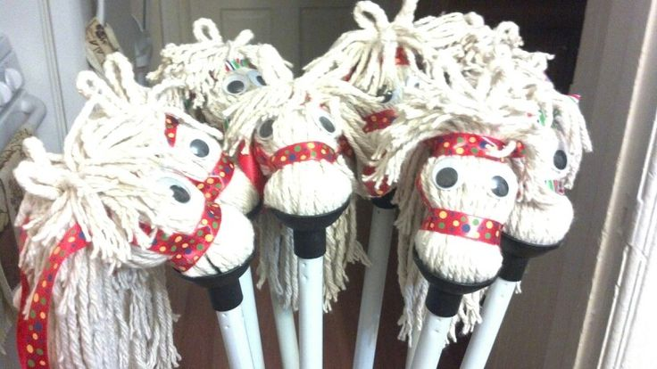 DIY stick horses made from dollar store mops for the cowgirl party.