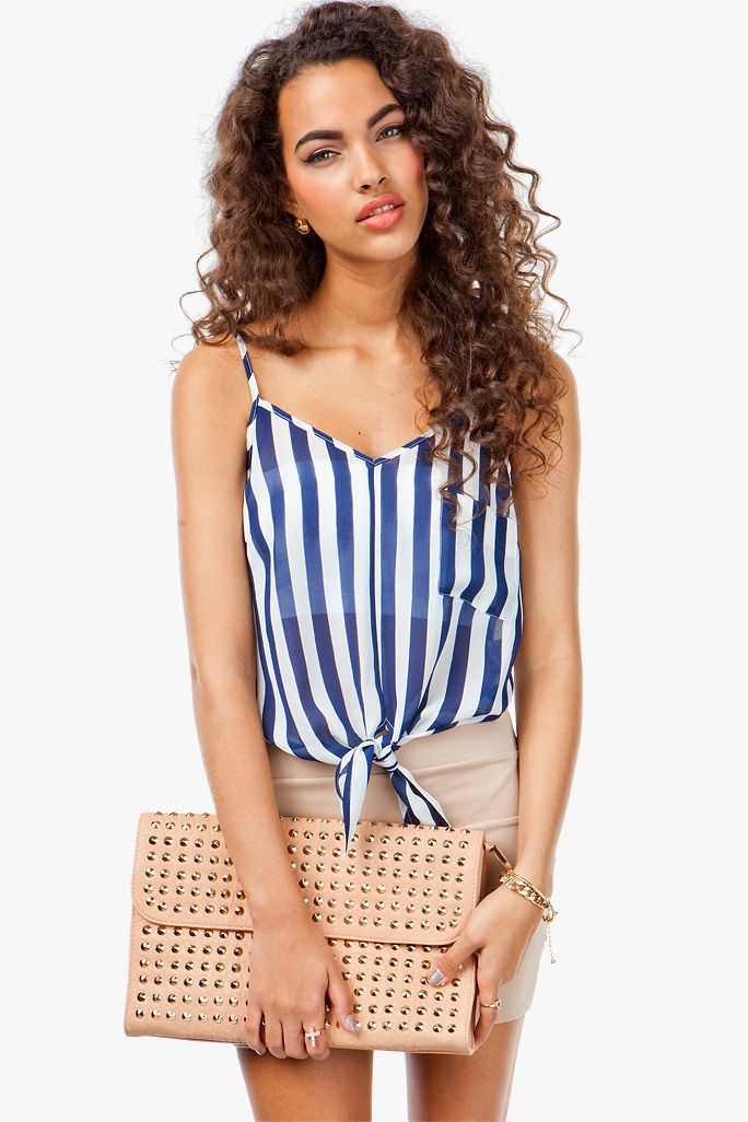 Feeling nautical? A super cute and flirty cami top with a vertical striped body and a tie front detail. Adjustable cami straps. Double V neck. Single strap across back.
