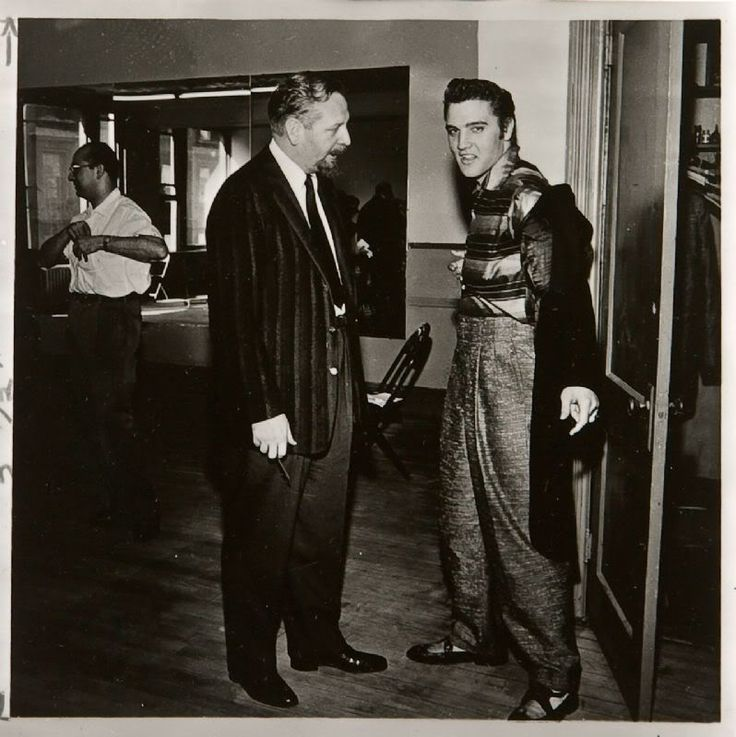 Fri. June 29, 1956 in NYC | The tux fitting for the ill-fated Steve Allen Show appearance. Skitch Henderson, Elvis Presley: Hudson Theater, New York, NY, Friday, June 29, 1956