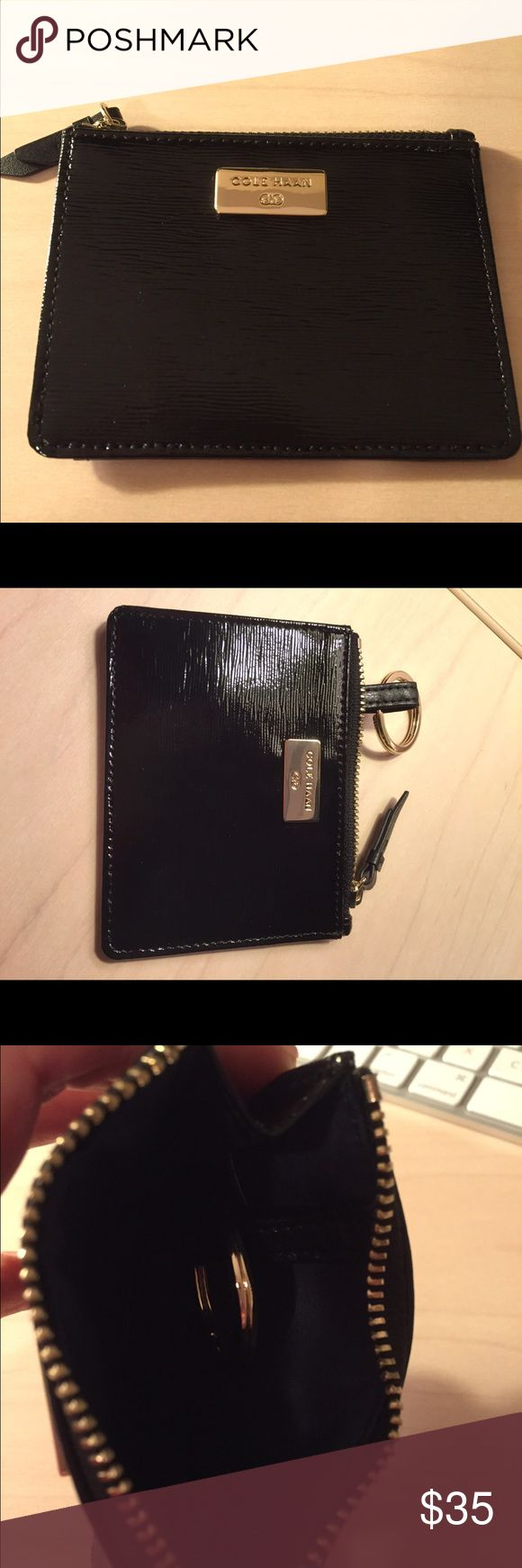 """Cole Haan patent key/money holder New and never been used Cole Haan key and money holder.  Patent black leather with clear insert for drivers license.  Gold zipper and front logo.  Measures approx 4.5"""" X 3.5"""". Cole Haan Accessories Key & Card Holders"""