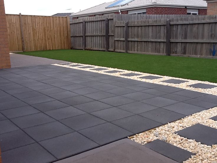 Charcoal pavers white pebble and artificial turf done by for Paved front garden designs