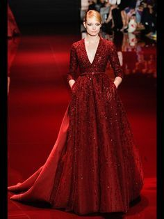 8. Elie Saab Haute Couture 2014: this gown was inspired by the gowns from the Late Middle Ages, with its smooth fit throughout the bodice then fulling out above the hips, long tight-fitting sleeves, deep-v neckline and belt under the breast