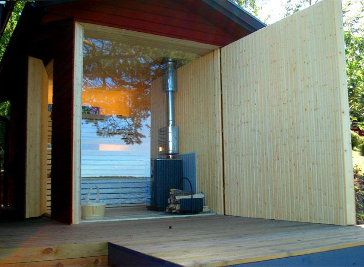 this sauna, designed by swedish firm vision division, has a swinging front facade that, when closed, looks like a normal shed, and when open creates a striking expanse of glass leading into the sauna… via materialicious