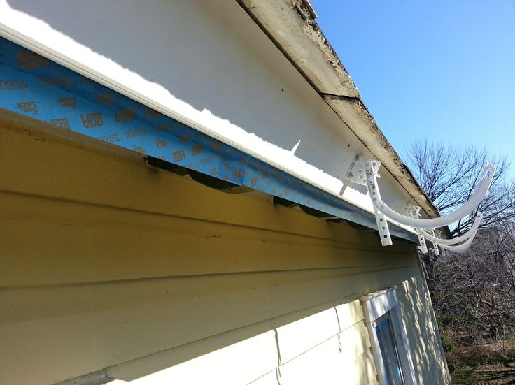 Installing Half Round Gutters and Downspouts on a Victorian Home