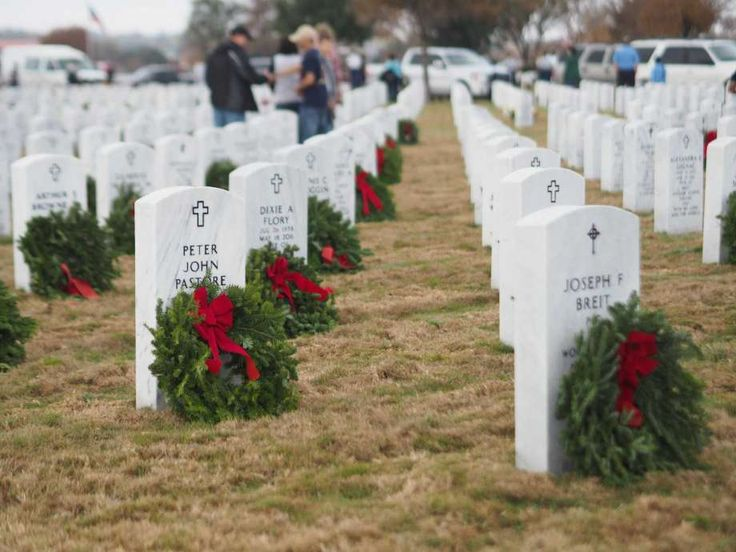 More than 4000 volunteers placed 35,951 Christmas wreaths on the gravestones of veterans at Fort Sam Houston National Cemetery, San Antonio, Texas, Dec. 17, 2016 as part of a national campaign from Wreaths Across America. Photo by  J.P. Lawrence / San Antonio Express News