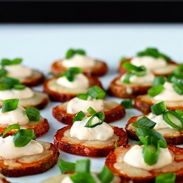30 Appetizers that will Rock your Party!! Sweet potato coins, roasted in the oven and topped with melted cheddar cheese and chipotle crema. They're the perfect, healthy finger food for entertaining! http//www.thefoodiephysician.com/2015/01/dining-with-doc-cheesy-sweet-potato.html""