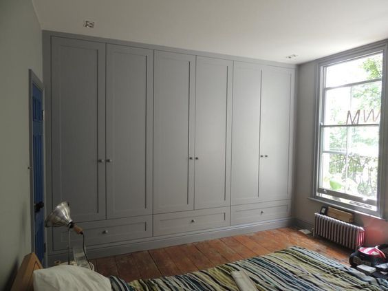 Loving the wide, double-span base drawers in these built in Shaker Style wardrobes.