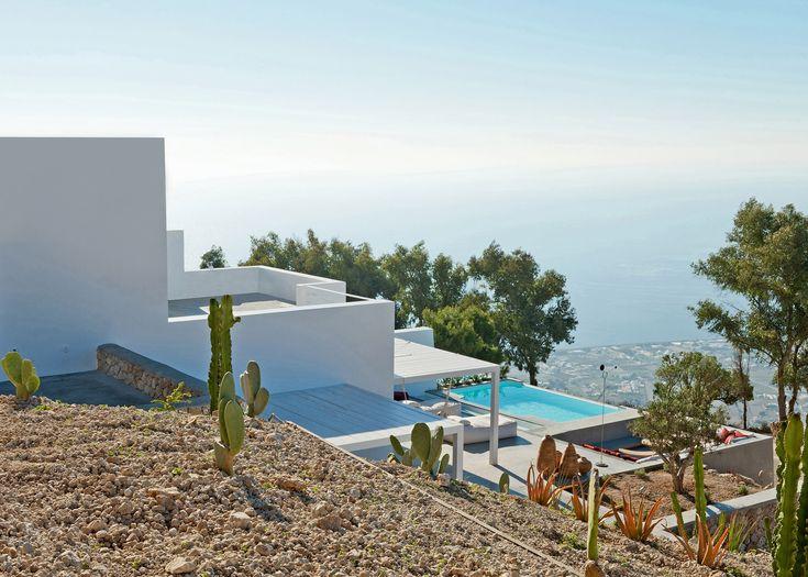 Kapsimalis Architects completes mountainside apartments near Santorini's highest point