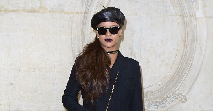 The sleek black leather beret Rihanna wore at Dior this afternoon had all the precision and the grit of the Black Panthers uniform.
