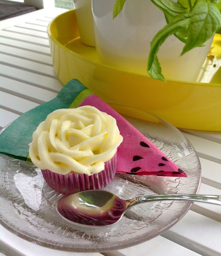 Carrot cup cake with cheese frosting.