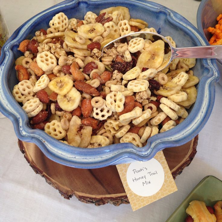 Honey Trail Mix for Winnie the Pooh baby shower - honeycomb cereal, Honey Nut Cheerios, Honey roasted nuts, banana chips, Craisins, and pumpkin flax granola.