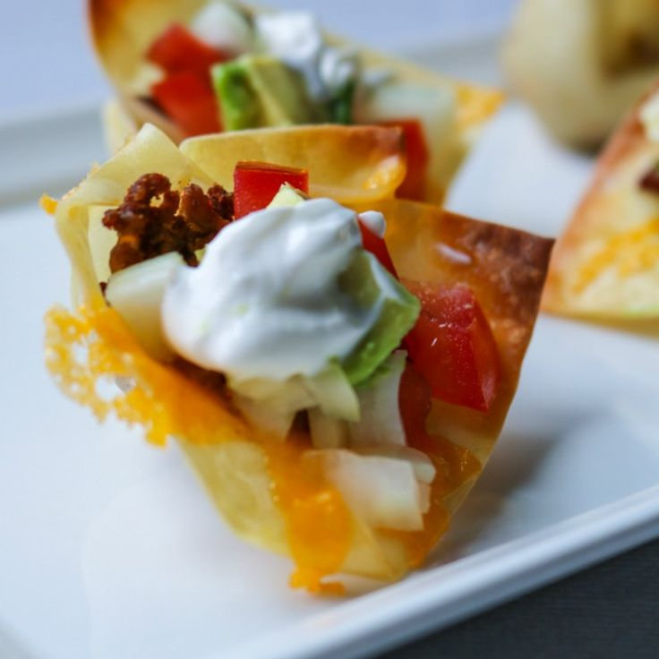 Wonton Taco Cups: Wonton wrappers are baked into little cups and stuffed just like a taco. Plus 60 recipes perfect for Football Viewing!