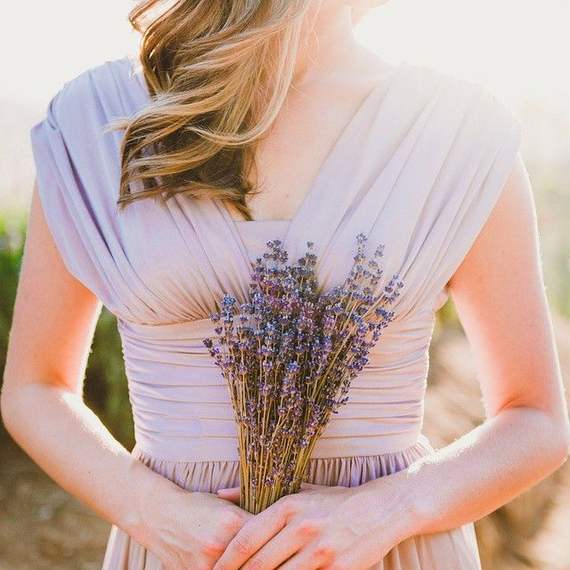 Oo La Lavender! A stunning dress and a stunning bouquet create the perfect pair. Xoxo @weddingchicks #lavender #bridesmaid #wedding #bouquet