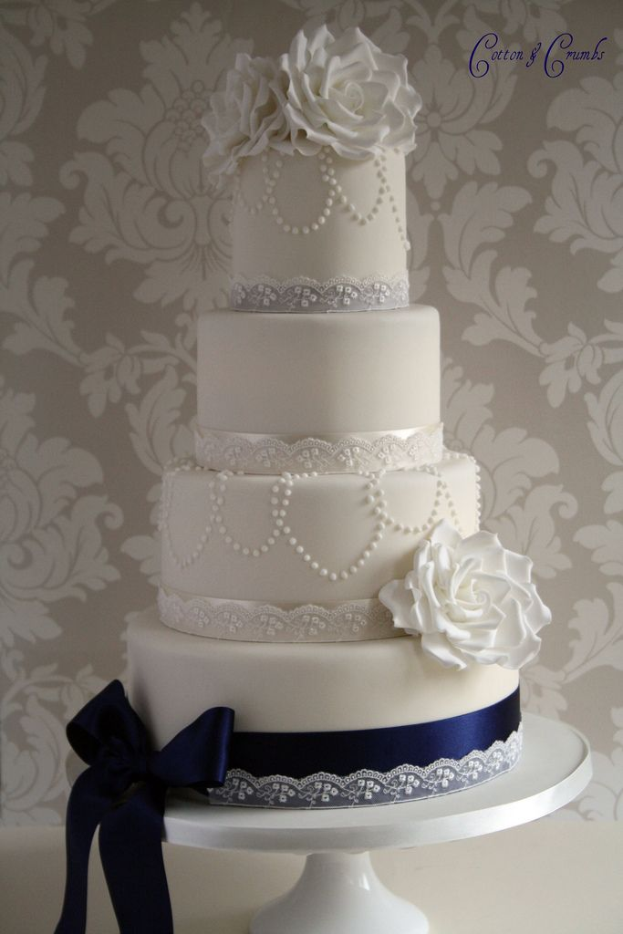 Pretty white wedding cake with beautiful flower accents—roses • bow • lace❣ Cotton & Crumbs • Flickr