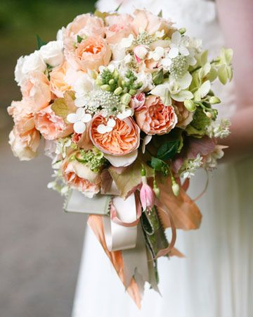 We love the cascading ribbons on this bouquet of garden roses, fuchsias, hydrangea, phalaenopsis orchids, and foxglove