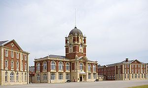 The Royal Military College (RMC), founded in 1801 and established in 1802 at Great Marlow and High Wycombe in Buckinghamshire, but moved in October 1812 to Sandhurst, Berkshire, was a British Army military academy for training infantry and cavalry officers of the British and Indian Armies.