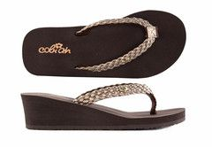 Lil' Eden Flip Flops for Girls $20.00. Lil' Eden Flip Flops for Girls by COBIAN is a Super Comfortable Wedge Heeled Shoe for Little Girls, available in Junior sizes. Rubber Sole, Manmade, Soft Braided Synthetic Strap, Comfortable and Fashionable Mid-Wedge.