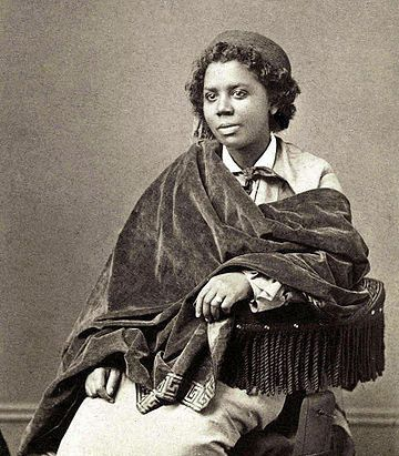 """""""Edmonia Lewis was the first African American artist to earn international fame for her artwork. She earned a living as a sculptor and portraitist and was famous for several of her works, including a bust of Colonel Robert Gould Shaw of which she sold over 100 plaster copies."""""""