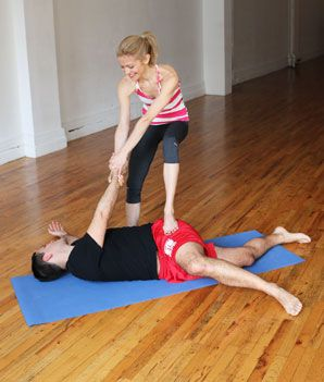 Supine Partner Spinal Twist - Hatha Yoga Poses for Couples - Shape Magazine