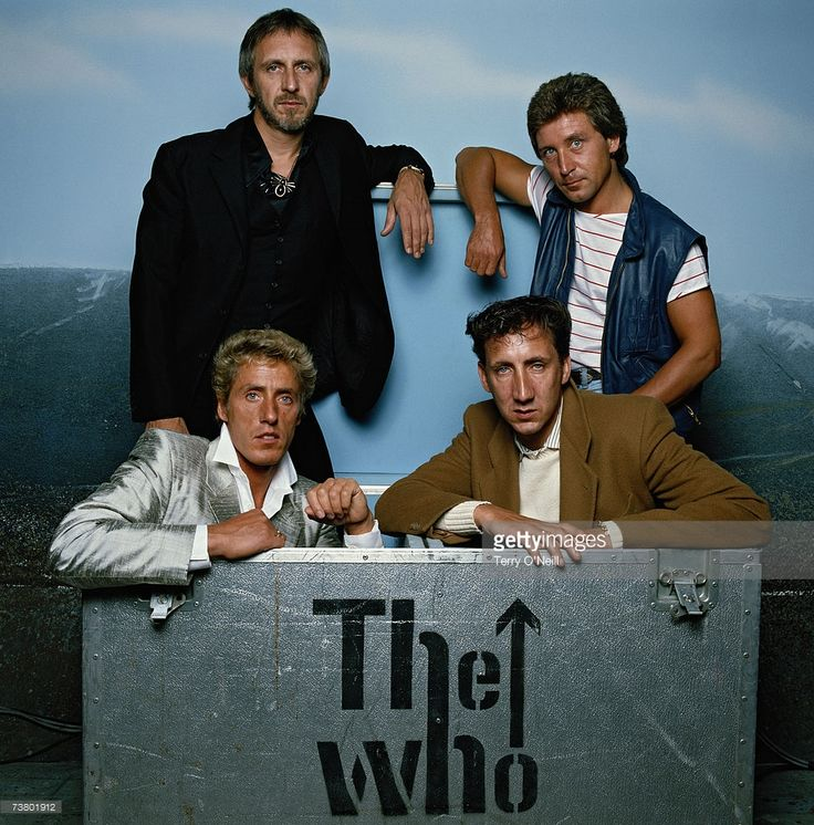 English rock group The Who pose in one of their flightcases, circa 1982. Clockwise from top left: bassist John Entwistle (1944 - 2002), drummer Kenney Jones, guitarist Pete Townshend and singer Roger Daltrey. Credit: Terry O'Neill