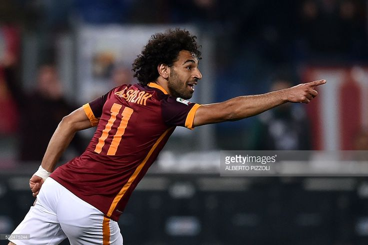 Roma's midfielder from Egypt Mohamed Salah celebrates after scoring during the Italian Serie A football match Roma vs Bologna on April 11, 2016 at Olympic stadium in Rome. / AFP / ALBERTO