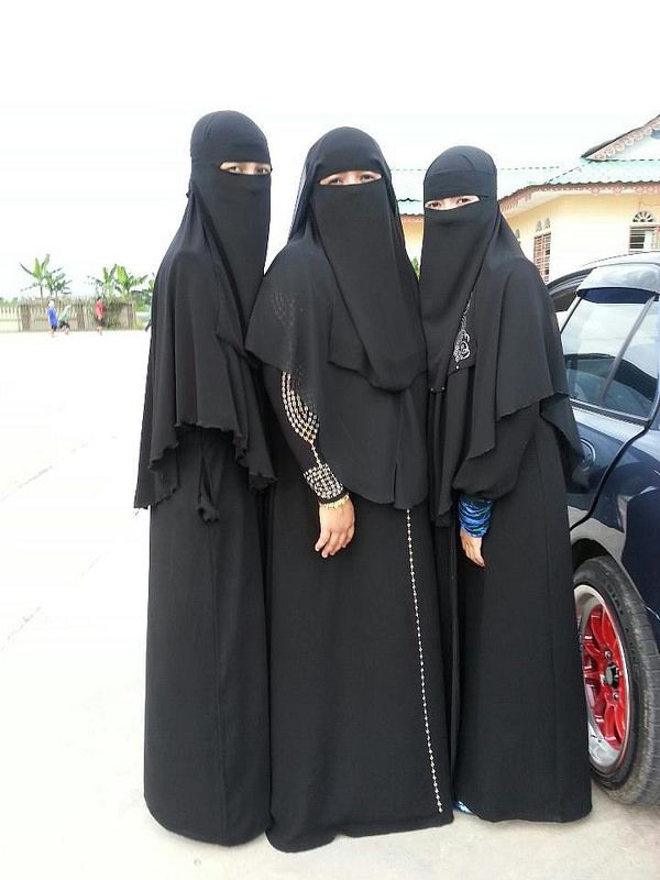 Muslimahs Standing by a Car Wearing Niqab and Abaya