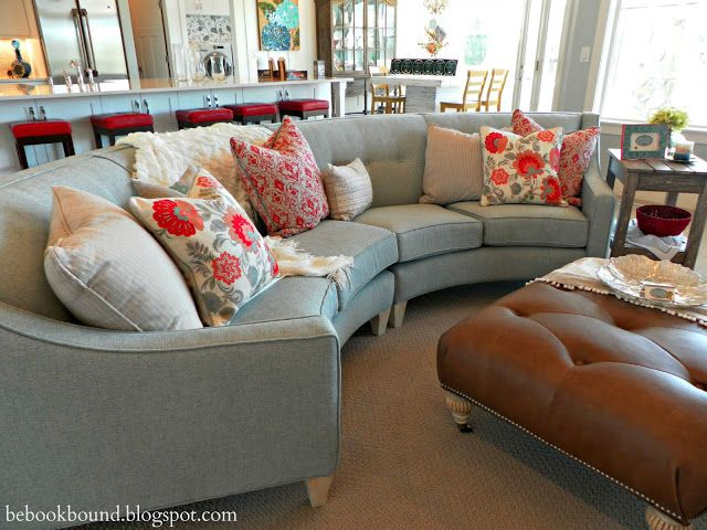 Living Room semi circular sofa sectional in a lovely blue gray color.
