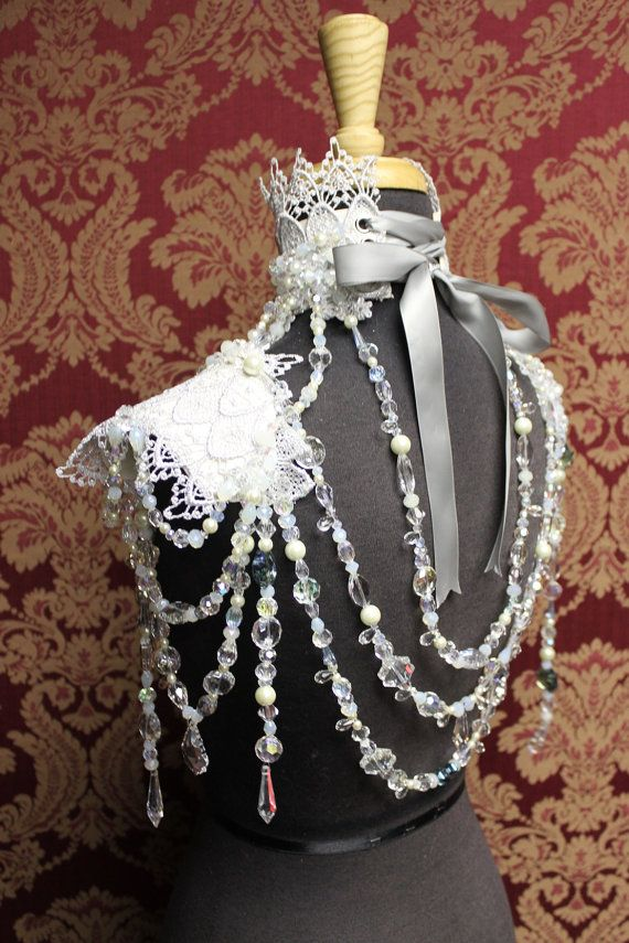 Beautiful, elegant and cold as winter like the snow queen herself. High neck collar of leather and silver lace, adorned with Swarovski crystals, glass