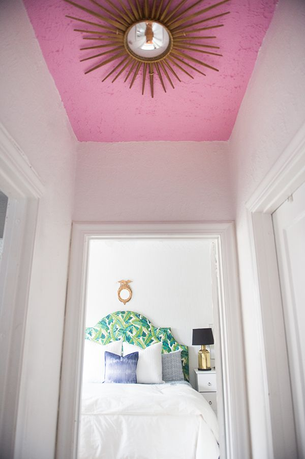 Love the idea of a gilded starburst mirror on a brightly colored ceiling