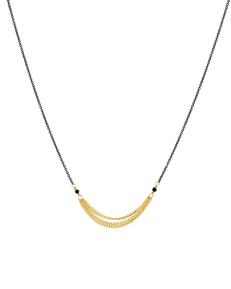 "Dana Kellin Multistrand Chain Necklace 	Oxidized silver chain necklace with gold multistrand chain detail feeding into delicate black spinel beads 	14k gold fill 	17"" long 	Lobster clasp closure"