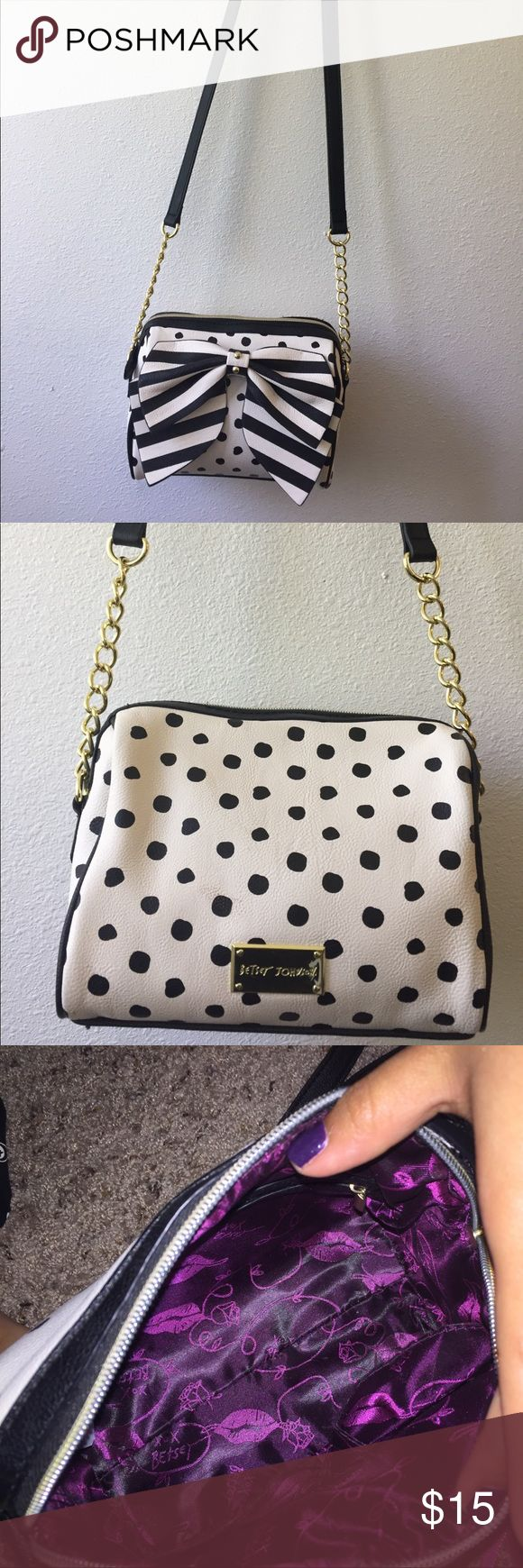 Betsey Johnson black and white purse This is a super fun/cute purse! I'm getting rid of it because I have too many purses! It's in very good condition and there is no rips or tears:) feel free to make offers! Betsey Johnson Bags Crossbody Bags