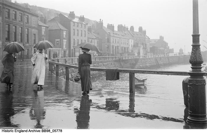 BB98/05778 General view showing people walking along Pier Road, Whitby in the rain  Photographer: Alfred Newton and Sons