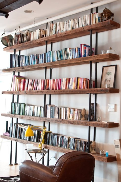Reclaimed wood and pipe bookshelves