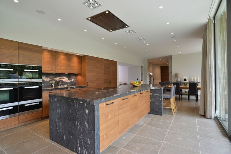 The large island in this open plan kitchen diner provides additional casual seating and extra storage and food preparation space; create a functional yet beautiful design element #kitcheninspiration