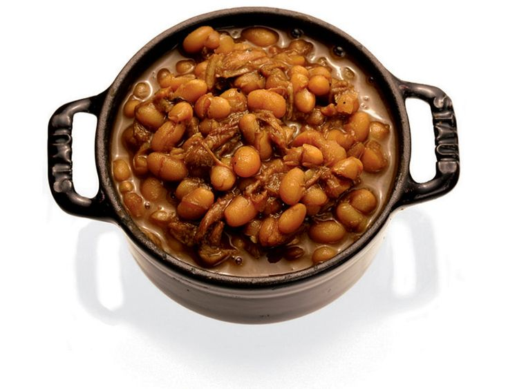 NYT Cooking: The trick to good baked beans is cooking them very slowly with indirect heat. This recipe calls for baking them in a tightly sealed casserole in an oven barely hot enough to toast bread. As the hours pass, the beans drink up a broth flavored with brown sugar (or molasses), mustard and pepper. The gentle cooking prevents the beans from breaking up and becoming mushy. By the time they're done, the pork is falling off its bones and the beans are the classic rusty brown. Be sure to…