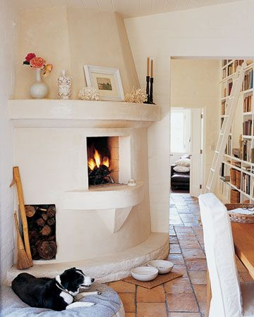 LOVE the little fireplace in the kitchen and the bookshelf wall in the next room