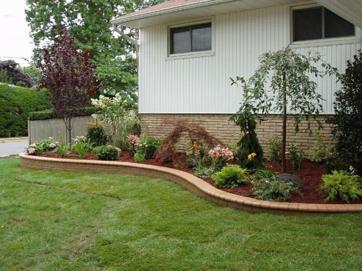 Retaining wall front yard ideas yard pinterest front for Townhouse landscaping ideas for front yard