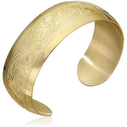 14K Yellow Gold-Filled Flower Pattern Design Cuff Bracelet Handcrafted in USA this shiny cuff bracelet is made from 14 karat yellow gold fill and displays a beautiful vine and flower pattern framed by polished borders. The cuff bracelet measures 7 inches long has a smooth polished interior and slips comfortably over the wrist. The cuff design has been embossed with an intricate floral pattern by a skilled craftsman and is easy to wear with any outfit and the pretty detailing makes this…