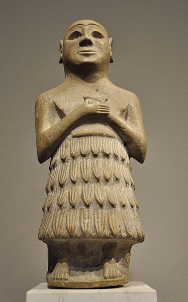 Sumerian man wearing a spiraled and folded garment.